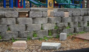 crumbling playground wall
